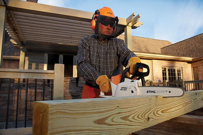 Stihl Battery Chainsaw MSA 160 cutting a block
